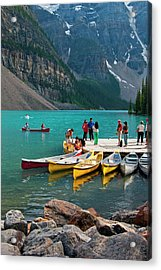 Passengers Renting Colourful Canoes On Acrylic Print by Emily Riddell