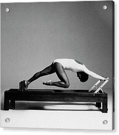 Paula Kelly Exercising On The 'reformer' Machine Acrylic Print by Francesco Scavullo