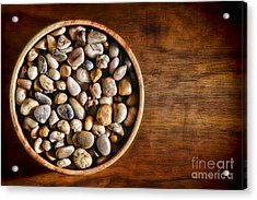 Pebbles In Wood Bowl Acrylic Print by Olivier Le Queinec