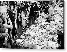 people buying chocolates on display inside the la boqueria market in Barcelona Catalonia Spain Acrylic Print by Joe Fox