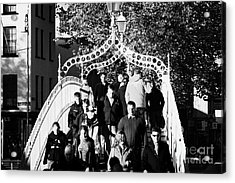 People Crossing The Hapenny Ha Penny Bridge Over The River Liffey In Dublin At A Busy Time Acrylic Print by Joe Fox