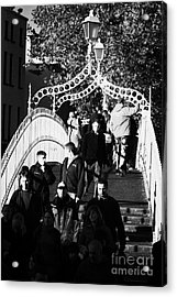 People Crossing The Hapenny Ha Penny Bridge Over The River Liffey In Dublin At A Busy Time Vertical Acrylic Print by Joe Fox
