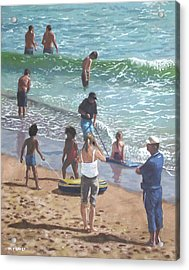 people on Bournemouth beach pulling dingys Acrylic Print