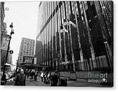 people on the sidewalk outside madison square garden with US flags flying new york city Acrylic Print by Joe Fox