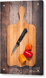 Peppers And Knife On Cutting Board Acrylic Print by Sharon Dominick