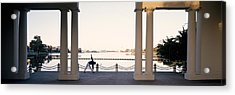 Person Stretching Near Colonnade, Lake Acrylic Print by Panoramic Images