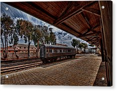 platform view of the first railway station of Tel Aviv Acrylic Print by Ron Shoshani