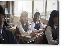 Portrait Of Happy High School Girls In Classroom Acrylic Print by Xavier Arnau