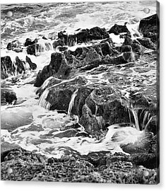 Pouring Rocks Acrylic Print by David Davies