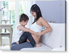 Pregnant Woman Sitting On Sofa With Son Acrylic Print