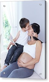 Pregnant Woman With Son Kissing Forehead Acrylic Print by Ruth Jenkinson