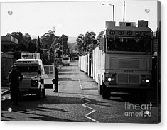 Psni Landrover And Watercannon In Wait In Preparation On Crumlin Road At Ardoyne Shops Belfast 12th  Acrylic Print by Joe Fox