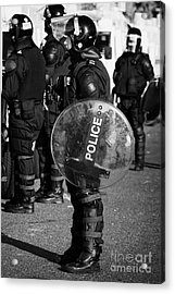 Psni Officer In Full Riot Gear With Shield On Crumlin Road At Ardoyne Shops Belfast 12th July Acrylic Print by Joe Fox