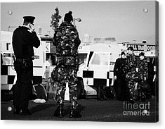 Psni Officers And British Army Soldiers At Psni Landrovers On Crumlin Road At Ardoyne Shops Belfast  Acrylic Print by Joe Fox