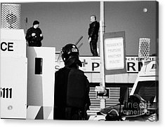 Psni Officers In Protective Riot Gear At Landrovers And Snipers On Crumlin Road At Ardoyne Shops Bel Acrylic Print
