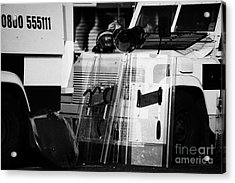 Psni Protective Riot Gear At Landrovers On Crumlin Road At Ardoyne Shops Belfast 12th July Acrylic Print by Joe Fox
