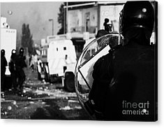 Psni Riot Officer With Baton Round Warning On Shield Watches Rioting On Crumlin Road At Ardoyne Shop Acrylic Print