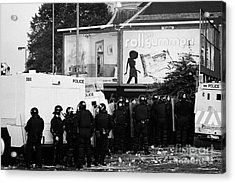 Psni Riot Officers Behind Armoured Land Rover Water Cannon Beneath On Crumlin Road At Ardoyne Shops  Acrylic Print