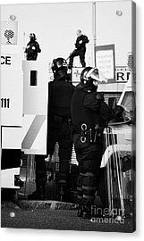 Psni Riot Squad Officers In Protective Gear And Snipers On Crumlin Road At Ardoyne Shops Belfast 12t Acrylic Print by Joe Fox