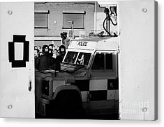 Psni Surveillance Land Rover Watches Crowd On Crumlin Road At Ardoyne Shops Belfast 12th July Acrylic Print by Joe Fox