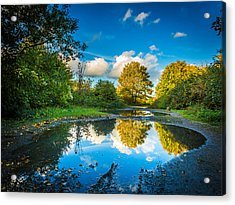 Acrylic Print featuring the photograph Puddles. by Gary Gillette