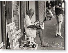 Quepos Street Artist Acrylic Print by Russell Christie