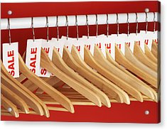 Rail Of Clothes Hangers With Sale Tags Attached, Close-up Acrylic Print by Martin Poole