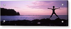 Rear View Of A Woman Exercising Acrylic Print by Panoramic Images