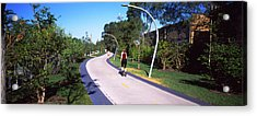 Rear View Of Woman Jogging In A Park Acrylic Print