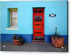 Red Door On Blue Wall Acrylic Print by Joe Kozlowski