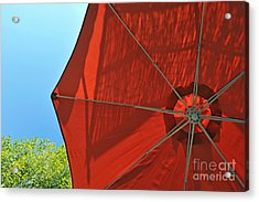 Reddish Umbrella Against Blue Sky Acrylic Print by Sami Sarkis