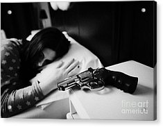 Revolver Handgun On Bedside Table Of Early Twenties Woman In Bed In A Bedroom Acrylic Print by Joe Fox
