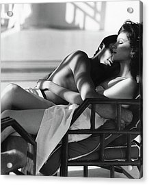 Rosie Vela Resting In A Chair With A Male Model Acrylic Print by Arthur Elgort