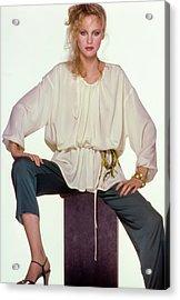 Rosie Vela Sitting On A Pedestal Wearing A White Acrylic Print