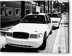 Row Of Yellow Cab Taxis In Miami South Beach Florida Usa Acrylic Print by Joe Fox
