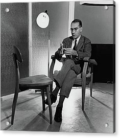 Russel Wright Sitting On A Chair Examining A Clay Acrylic Print