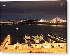 San Francisco Embarccadero And Bay Bridge Lights Acrylic Print by Ron McMath