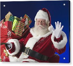 Santa Claus Next To Bag Of Toys Acrylic Print by Tetra Images