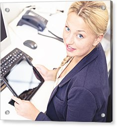 Secretary In Her Office Using A Digital Tablet Acrylic Print by Franckreporter
