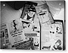 selection of leaflets advertising girls laid out on a hotel bed in Las Vegas Nevada USA Acrylic Print by Joe Fox