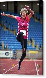 Senior British Female Athlete Mid-air Acrylic Print by Alex Rotas