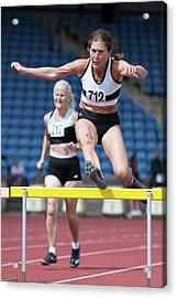 Senior Female Athlete Clears Hurdle Acrylic Print by Alex Rotas
