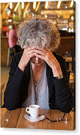 Senior Woman In Cafe With Head In Hands Acrylic Print by Lea Paterson
