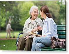 Senior Woman With Caregiver In The Park Acrylic Print by FredFroese