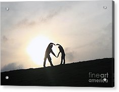 Silhouette Couple Forming A Heart Acrylic Print by Lars Ruecker