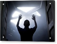 Silhouette Of A Man With Raised Hands Against Light Coming From Above. Acrylic Print by Maciej Toporowicz, NYC