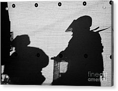 Silhouette Of British Army Soldiers On Screen On Crumlin Road At Ardoyne Shops Belfast 12th July Acrylic Print by Joe Fox