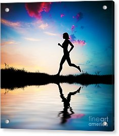 Silhouette Of Woman Running At Sunset Acrylic Print