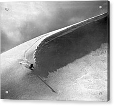Skiing Under A Curl Acrylic Print by Underwood Archives