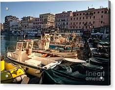 small working fishing boats moored stern first in Anzio harbour Acrylic Print
